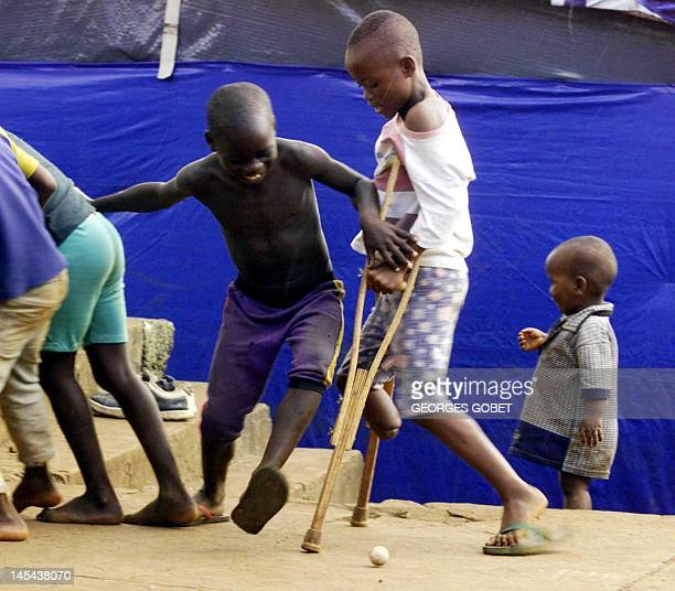 A picture taken on September 27 2011 shows boys who respectively got an arm and a leg chopped off during the decadeold civil war in Sierra Leone...