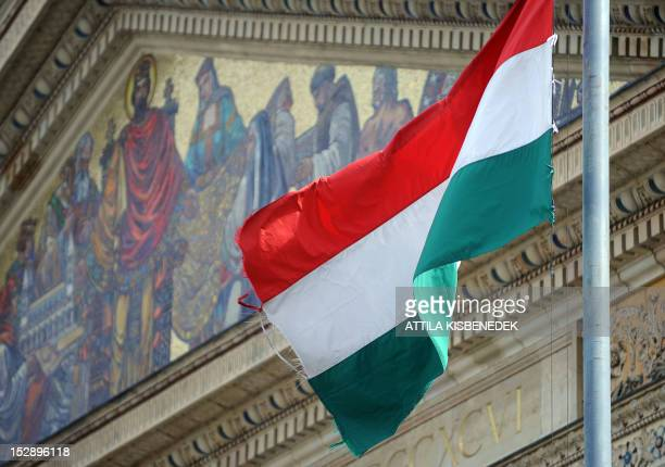 A picture taken on September 27 2012 shows the Hungarian flag in front of the Mucsarnok the Fine Arts Museum at Heroes square in Budapest with a...