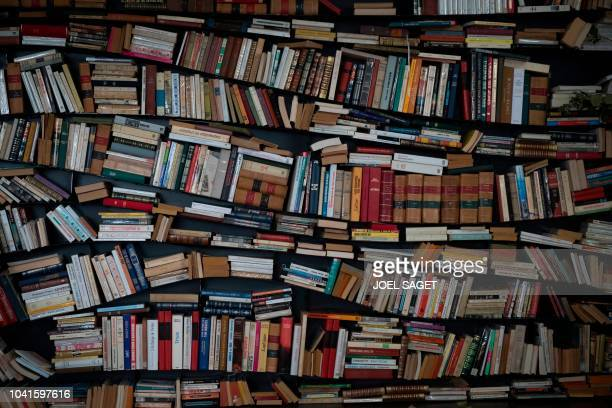 A picture taken on September 27 2018 in Manosque southern France during the 20th Les Correspondances literary festival shows a bookshelf in a street