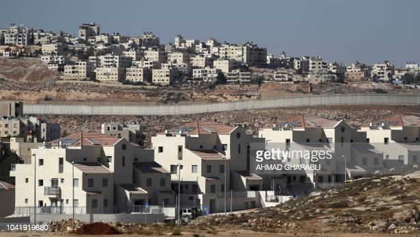 A picture taken on September 27 2018 shows Israel's controversial barrier separating the Jewish settlement of Neve Yaakov in the northern area of...