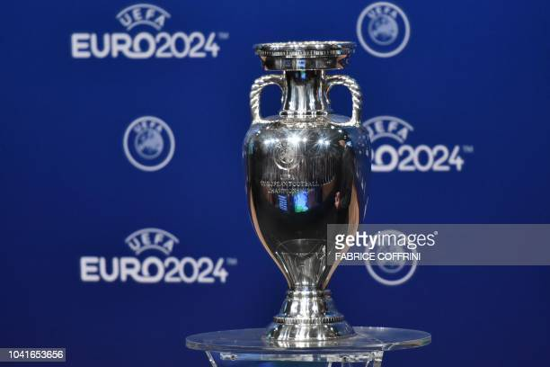 Picture taken on September 27, 2018 shows the UEFA Euro trophy on display few moments before the announcement of the elected country which will host...