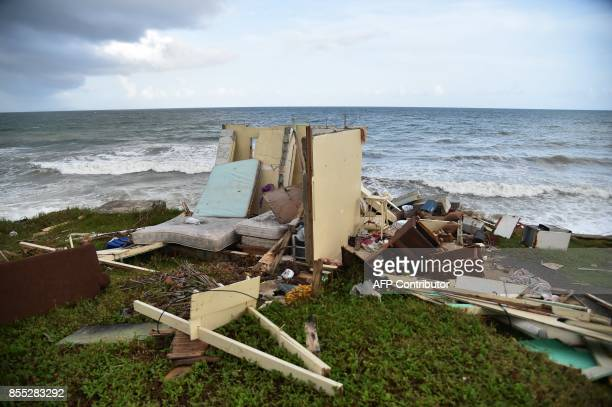 A picture taken on September 28 2017 shows a house destroyed by Hurricane Maria in Yabucoa in the eastern part of stormbattered Puerto Rico A week...