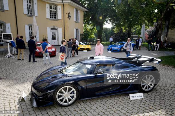 A picture taken on September 28 2019 at the Bonmont Abbey in Cheserex western Switzerland shows a 2015 Koenigsegg One1 model car during an auction...