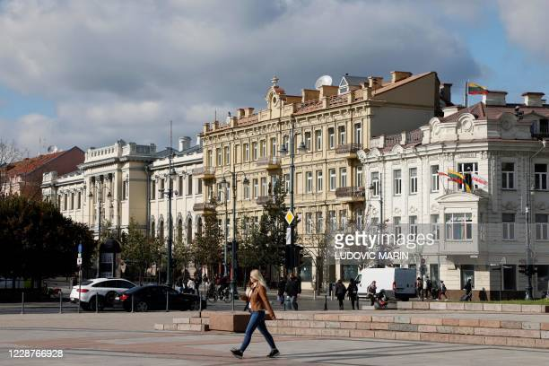 Picture taken on September 28, 2020 shows a woman walking through the city centre in Vilnius, Lithuania.