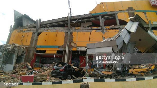 A picture taken on September 29 2018 shows a collapsed building after an earthquake and tsunami hit Palu on Sulawesi island Rescuers scrambled to...