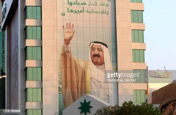 Picture taken on September 29, 2020 in Kuwait City shows a portrait of Kuwait's emir, Sheikh Sabah Al-Ahmad Al-Sabah. - Sheikh Sabah Al-Ahmad...