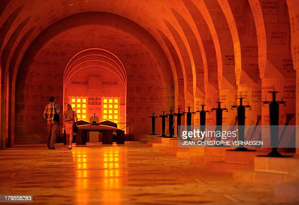 A picture taken on September 3 2013 shows the cloister of the ossuary of Douaumont in Douaumont eastern France The ossuary is a memorial containing...