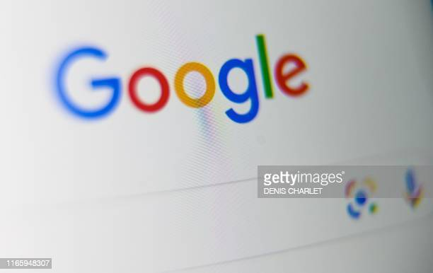 A picture taken on September 3 2019 shows the US multinational technology and Internetrelated services company Google logo displayed on a tablet...