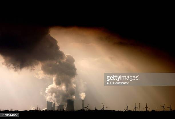Picture taken on September 30, 2009 shows smoke and vapor rising from the cooling towers and chimneys of the lignite-fired power plant Niederaussem...