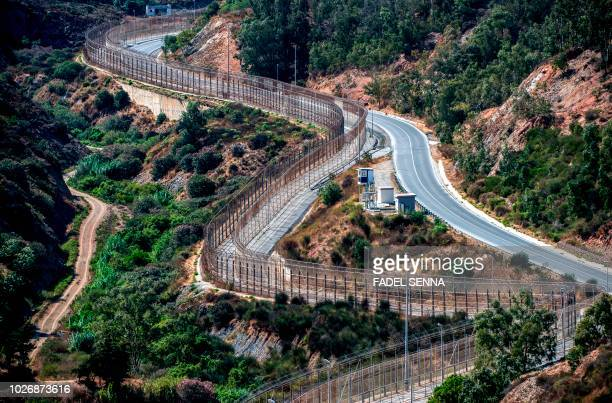 Picture taken on September 4, 2018 shows a view of a guard tower overlooking the border fence encircling Spain's North African enclave of Ceuta which...