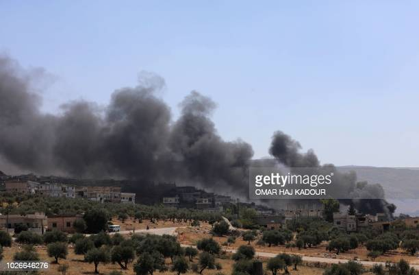 A picture taken on September 4 2018 shows smoke blowing from buildings on fire that were hit by reported Russian air strikes in the rebelheld town of...