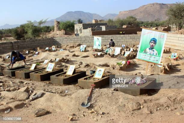 A picture taken on September 4 2018 shows the graves of Yemeni children who were killed while on a bus that was hit by a Saudiled coalition air...