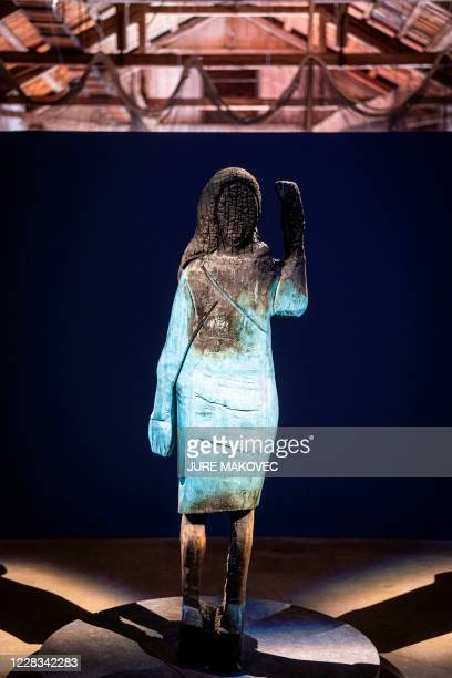 Picture taken on September 4, 2020 shows a charred wooden statue of Melania Trump, made by Slovenian conceptual artist Ales 'Maxi' Zupevc, on display...