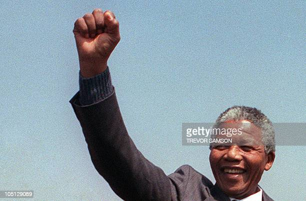 A picture taken on September 5 1990 shows antiapartheid leader and African National Congress member Nelson Mandela raising fist while addressing in...