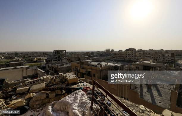 A picture taken on September 5 2017 shows a general view from the rooftop of a building of the western alDaraiya neighbourhood of the embattled...