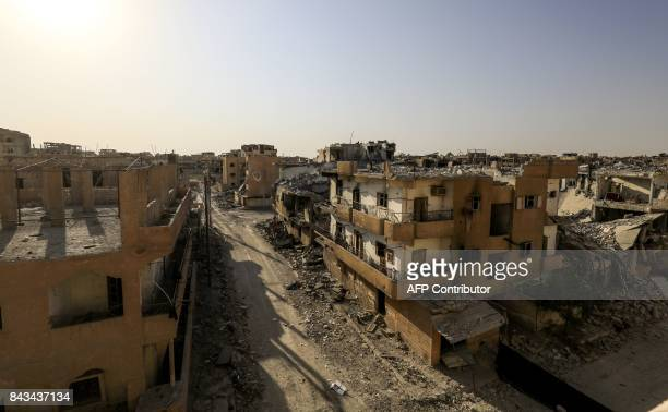A picture taken on September 5 2017 shows a general view of damaged buildings in the western alDaraiya neighbourhood of the embattled northern Syrian...