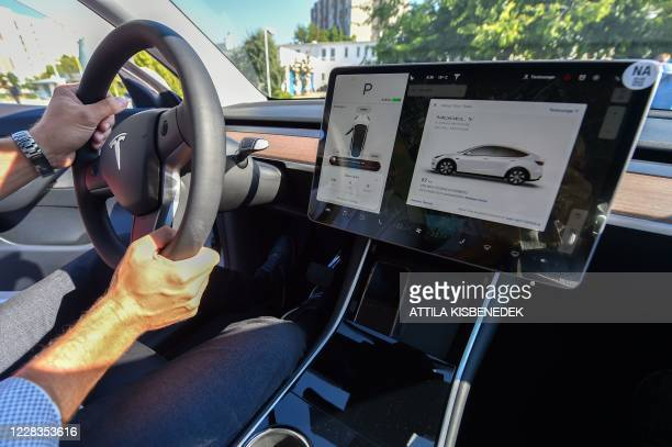 """Picture taken on September 5, 2020 shows an inside view of a """"Tesla Model Y"""" car, an all-electric compact SUV by US electric car giant Tesla, during..."""