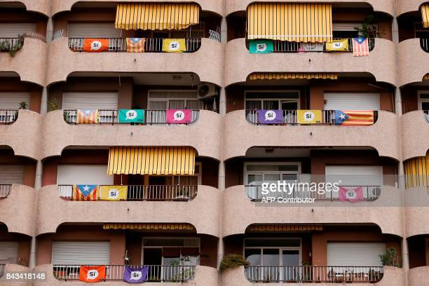 A picture taken on September 6 2017 shows a building with Esteladas and banners reading in Catalan YES in Barcelona Spain's central government has...