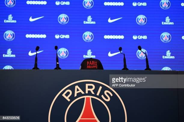 A picture taken on September 6 2017 shows a cap bearing the name of Paris SaintGermain's new recruit forward Kylian Mbappe before a press conference...