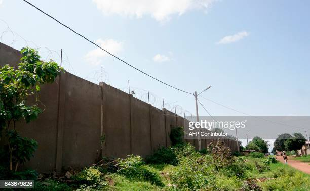 A picture taken on September 6 2017 shows the barbed wire atop of the prison wall in Katiola where nearly 100 inmates escaped 4 days ago This is the...