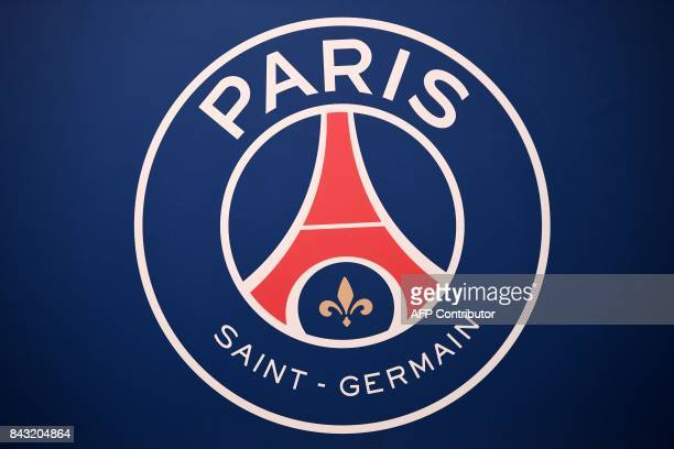 A picture taken on September 6 2017 shows the logo of the Paris SaintGermain's L1 football club displayed before a press conference at the Parc des...