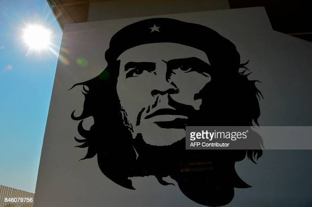 A picture taken on September 8 2017 shows a portrait of late Argentinian revolutionary legend Ernesto 'Che' Guevara painted on an exterior wall of...
