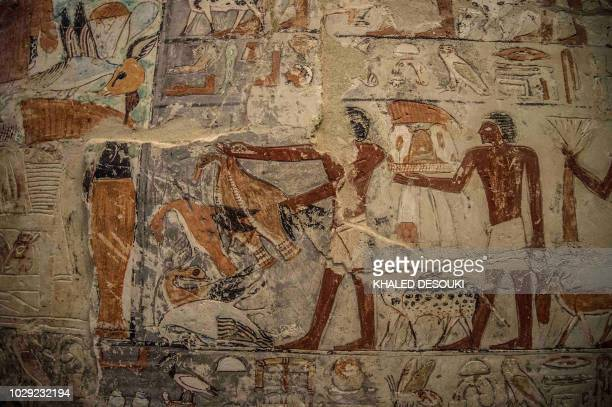 A picture taken on September 8 2018 shows the tomb of Mehu in the Saqqara necropolis south of the Egyptian capital Cairo during the inauguration for...