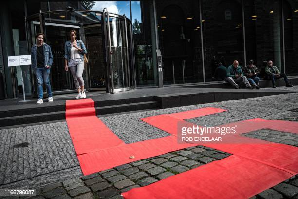 Picture taken on September 8, 2019 shows a Swastika formed with red carpets by artist Ralph Posset during the opening of an exhibition entitled...