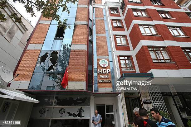 Picture taken on September 9 shows the facade of the Turkey's headquarters of the pro-Kurdish Democratic People's Party destroyed by a fire set by a...