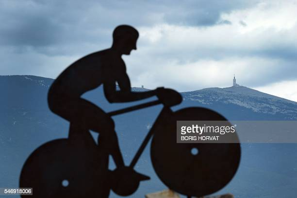 A picture taken on the Mont Ventoux on July 12 2016 two days before the passage of the Tour de France shows a sculpture of a cyclist with the Mont...