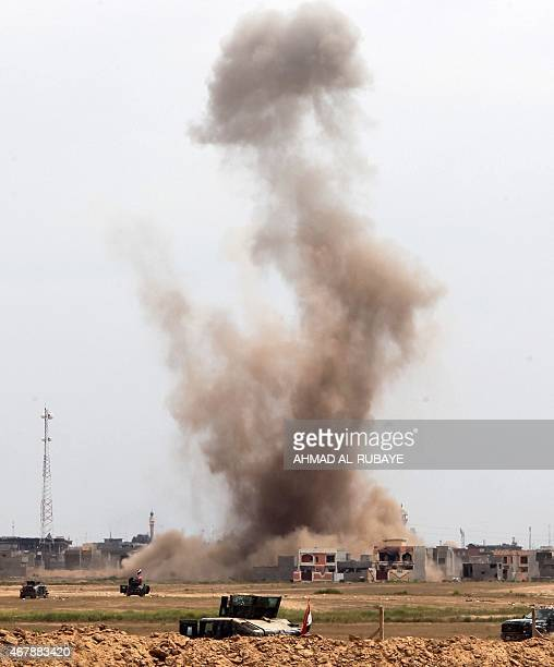 A picture taken on the western outskirts of Tikrit on March 28 2015 shows smoke rising from buildings during a military operation of Iraqi government...