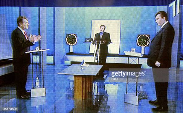 A picture taken on Ukraine's First National Channel TV grab showing Ukraine's Westernleaning opposition leader Viktor Yushchenko speaking with his...