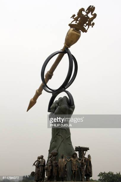 A picture taken outside Nigeria's National Assembly in Abuja on March 8 2016 shows an artistic monument picturing a hand holding a sceptre South...