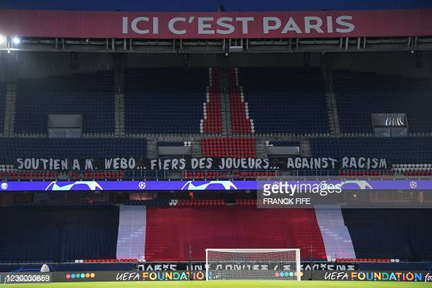 """Picture taken shows a banner reading """"Support to M. Webo - Proud of players - Against racism"""" displayed in an empty grandstand before the UEFA..."""