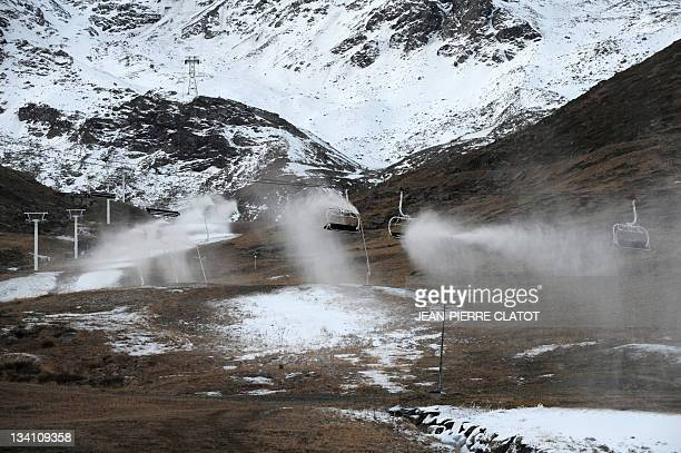 A picture taken shows snowmaking guns in action on November 26 2011 at a slope of Val Thorens winter sports resort on the opening day of the winter...