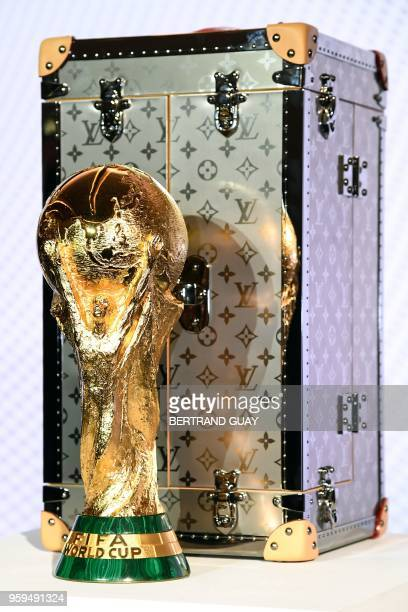 A picture taken shows the official case which will be used to carry the FIFA Russia 2018 World Cup trophy during its presentation at the Louis...