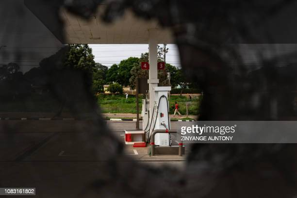 Picture taken through a broken window on January 15, 2019 shows a gas station near Cowdray Park township in Bulawayo, Zimbabwe. - The government more...