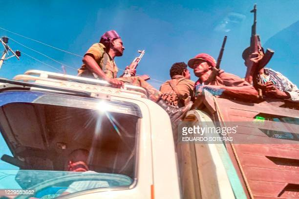 A picture taken through a car window shows Ethiopian Amhara militia fighters that combat alongside federal and regional forces against northern...