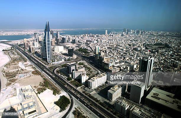 Picture taken through a window shows a general view of Bahrain's captial Manama and nearby cities on October 22, 2010. AFP PHOTO/MARWAN NAAMANI