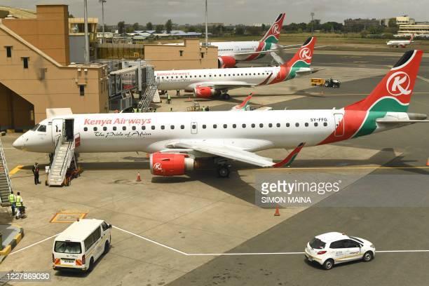 Picture taken through a window shows Kenya Airways planes parked at the parking bay at the Jomo Kenyatta international airport in Nairobi, on August...