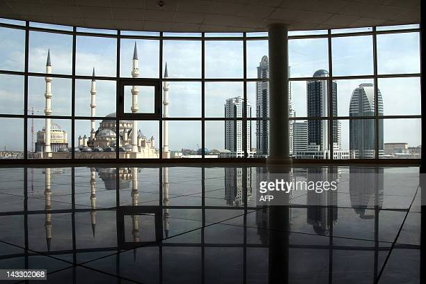 A picture taken through panoramic window of a building on April 14 shows the high rises of the new skyscraper complex GroznyCity Akhmad Kadyrov...