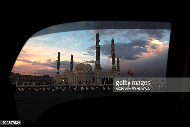 TOPSHOT A picture taken through the window of a car on February 26 2016 shows a general view of the alSaleh mosque in the Yemeni capital Sanaa / AFP...