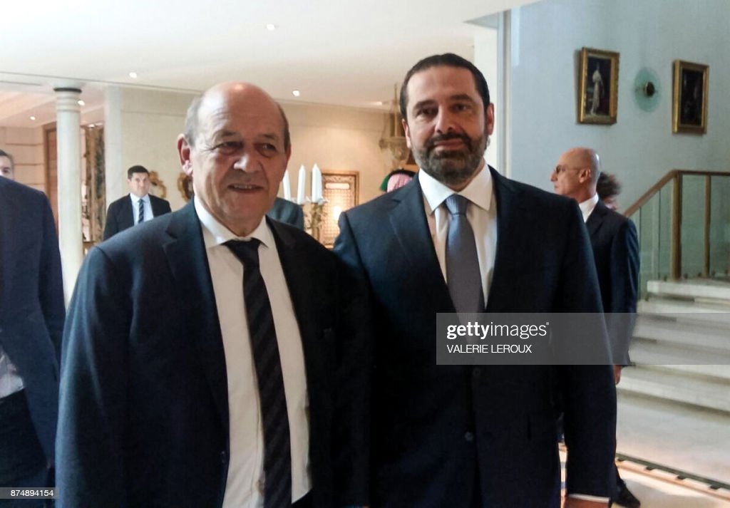 A picture taken with a cell-phone on November 16, 2017, shows French Foreign Minister Jean-Yves Le Drian posing for a photo with Lebanese Prime Minister Saad Hariri in the Saudi capital Riyadh. Hariri met with Le Drian in Riyadh on November 16, the most senior Western official he has met publicly since his shock resignation announcement earlier this month. The meeting came after the French foreign minister said that Hariri had accepted an invitation to visit France for talks with President Emmanuel Macron. / AFP PHOTO / Valérie LEROUX