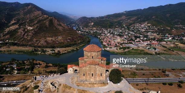 A picture taken with a drone on August 22 2017 shows a view of the 6th century Jvari monastery and the confluence of the Aragvi and the Kura rivers...