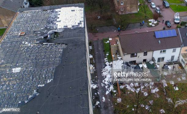 A picture taken with a drone on January 18 2018 in Duisburg northern Germany shows the damage caused by strong winds at a secondary school Violent...