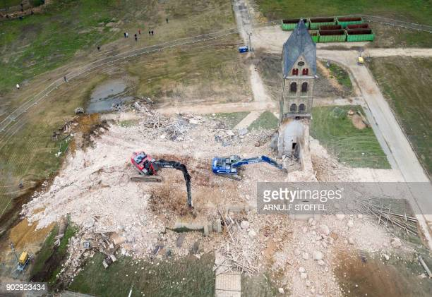 Picture taken with a drone on January 9 2018 shows the desacralized St Lambertus church in ErkelenzImmerath western Germany being demolished in order...