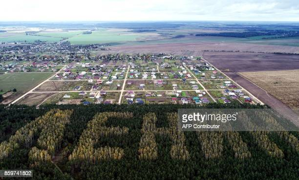 """Picture taken with a drone on October 10, 2017 shows trees spelling out the word """"Lenin"""" in a forest near the town of Ivanava, some 305km southwest..."""