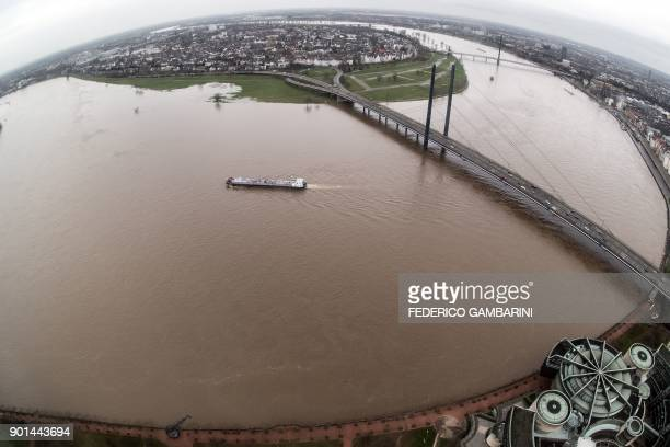 A picture taken with a fish eye lens on January 5 2018 shows a view of the Rhine river whose water level has risen high following heavy rains in...