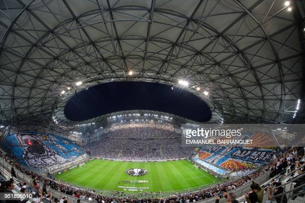 TOPSHOT A picture taken with a fisheye lens on April 26 2018 shows spectators watching the ceremony ahead of the UEFA Europa League firstleg...