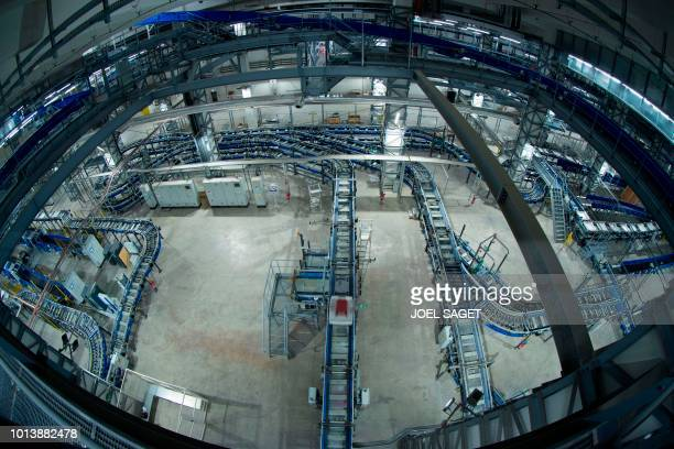 A picture taken with a fisheye lens on August 8 2018 shows the baggage sorting centre at the RoissyCharles de Gaulle airport in RoissyenFrance north...